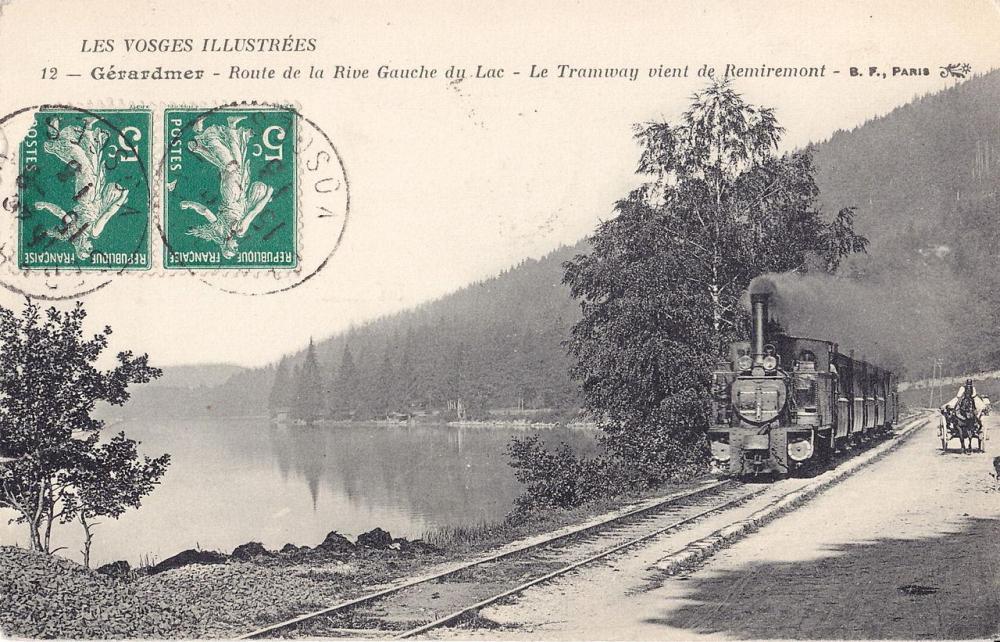 GERARDMER_-_Route_de_la_Rive_Gauche_du_Lac_-_Le_Tramway_vient_de_Remiremont.thumb.jpg.d55cbf17a7f37197c21ec4fed556c450.jpg